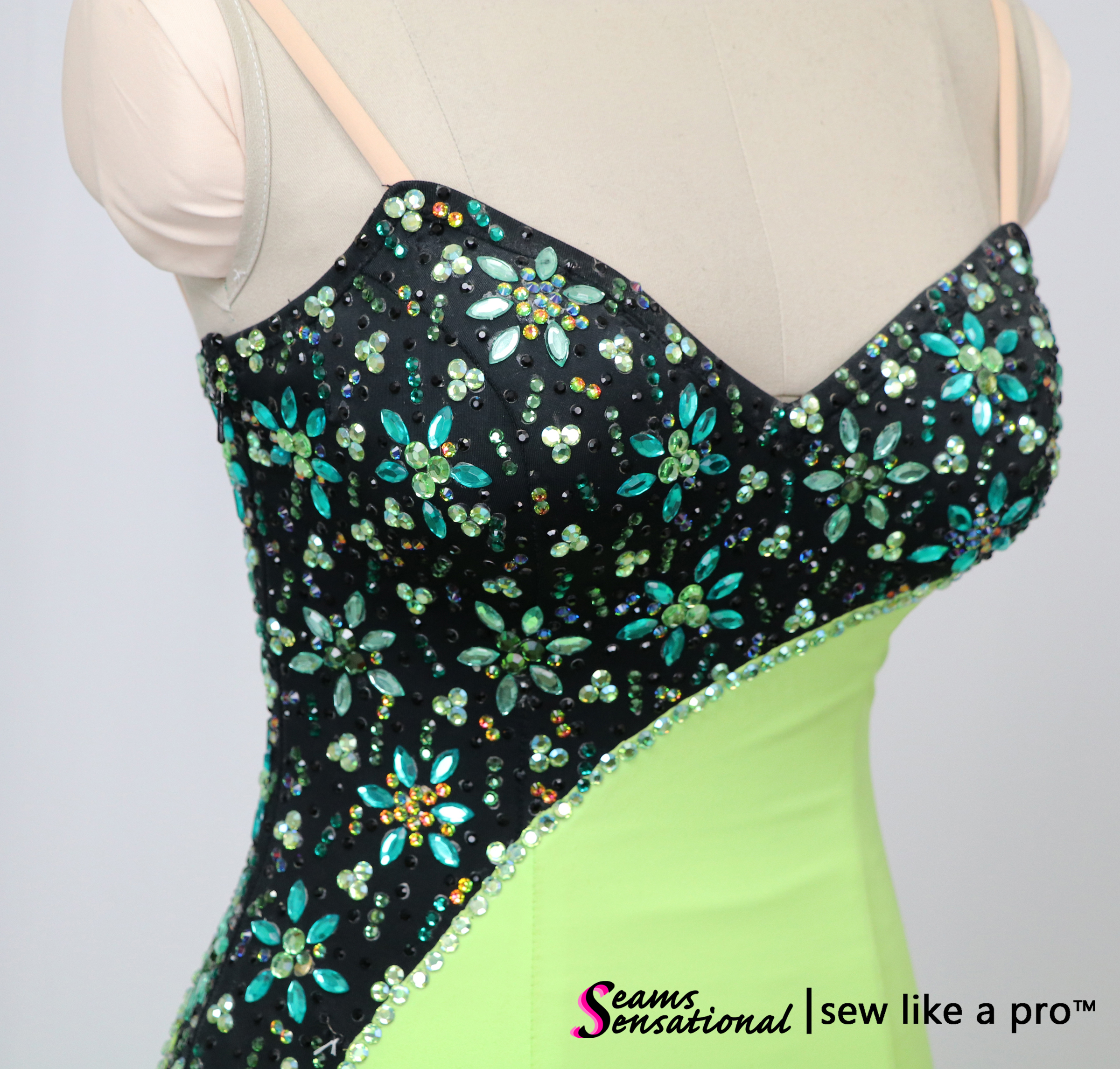 Key design element: feminine rhinestoning pattern on the competition Dancesport ballgown