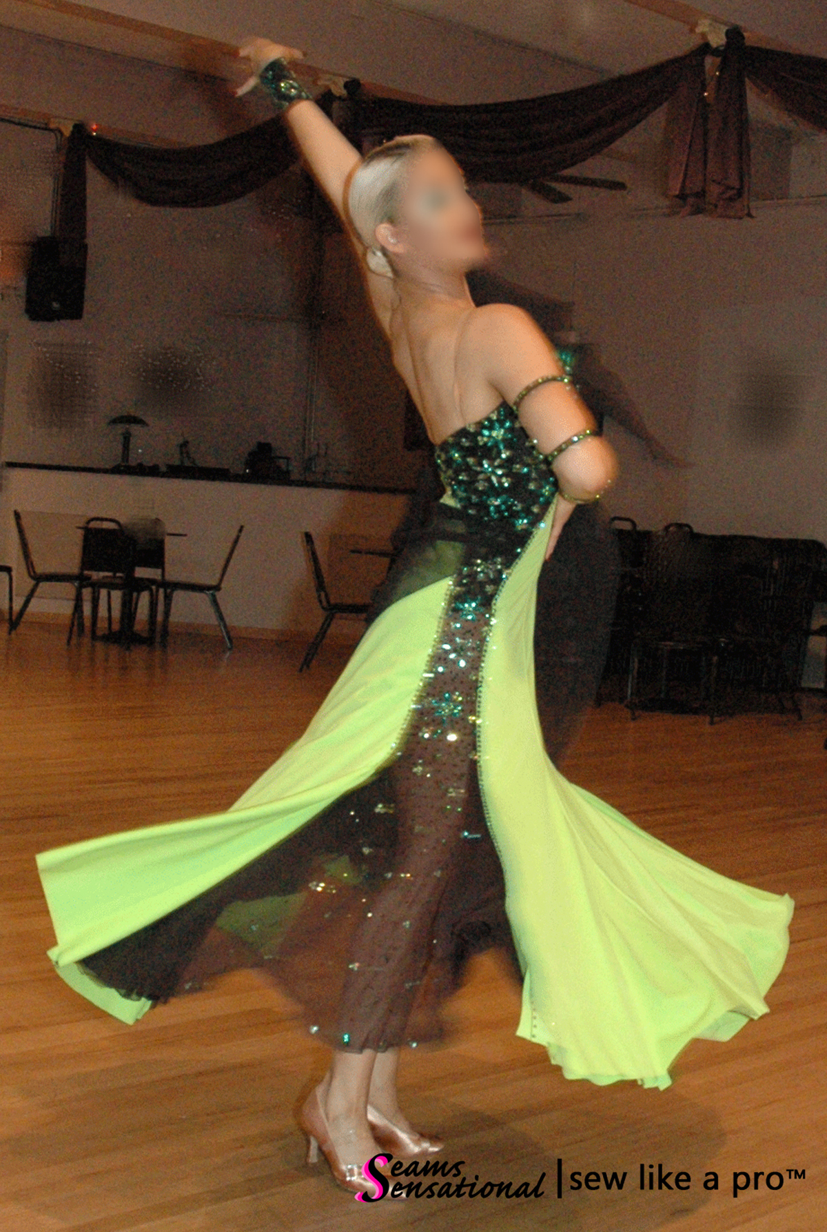 Key design element: contrasting sheer skirt panel on the competition Dancesport ballgown